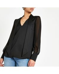 River Island - Black Satin Tie Neck Blouse - Lyst