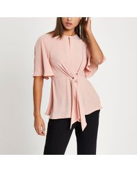 River Island - Light Pink Tie Front Short Sleeve Blouse - Lyst