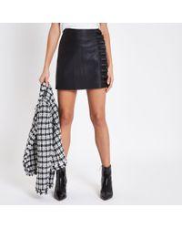 River Island - Black Faux Leather Frill Side Mini Skirt - Lyst