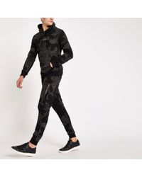 Criminal Damage Baroque Print sweatpants - Black