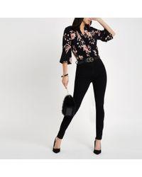 River Island - Black Floral Wrap Bodysuit - Lyst