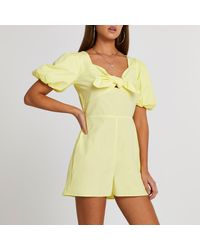 River Island - Yellow Puff Sleeve Bow Front Playsuit - Lyst