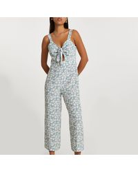 River Island Blue Sleeveless Floral Front Tie Jumpsuit