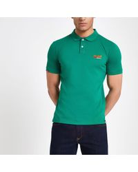 7b581292cf Lacoste Andy Roddick Superdry Polo in White for Men - Lyst