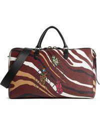 Roberto Cavalli Reisetasche mit Heritage Zebra Print - Rot