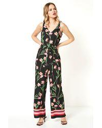 Roman Originals - Floral Border Print Jumpsuit - Lyst