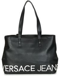 14de64d0a48f Versace Jeans Stitch Quilt Bag Black in Green - Lyst