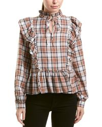 Lucca Couture - Indiana Peplum Blouse - Lyst
