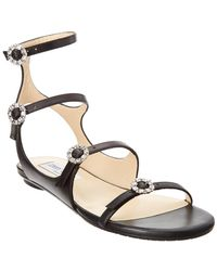 4e85b8db56fa Jimmy Choo Naia Crystal Buckle Suede Sandal in Black - Lyst