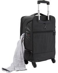 Genius Pack 22in Carry-on Spinner - Black