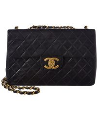 Chanel - Black Quilted Lambskin Leather Maxi Half Flap Bag - Lyst