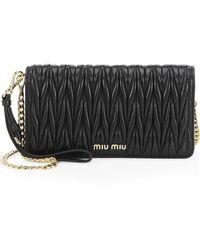 6492ec3c190 Miu Miu - Women s Matelasse Leather Wristlet - Cromo - Lyst