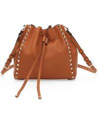 Valentino - Small Rockstud Leather Bucket Bag - Lyst