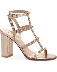 9761079643 Valentino - Women's Rockstud Metallic Leather Cage Sandals - Bronze - Lyst