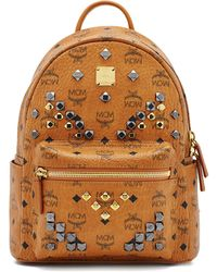 MCM - Small Stark M Stud Small Coated Canvas Backpack - Lyst
