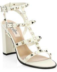Valentino Garavani Rockstud Patent Leather Sandals - White