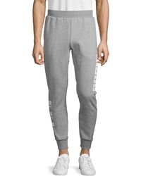 PUMA Regular-fit Cotton-blend Jogger Trousers - Grey