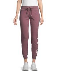 Calvin Klein Logo Cotton-blend Cropped Jogger Trousers - Purple
