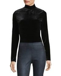 Elie Tahari - Didi Velvet Turtleneck Bodysuit - Lyst