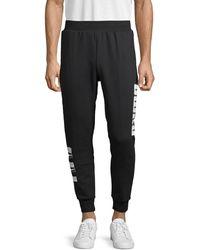 PUMA Side Logo Graphic Cotton-blend Jogger Pants - Black