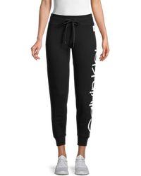 Calvin Klein Women's Jumbo Logo Sweatpants - Moon Rock - Size L - Black