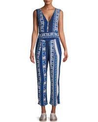 194d5348c6c Lyst - Free People Maribelle Printed Halter Neck Jumpsuit in Blue