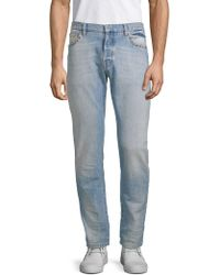 Valentino - Rockstud Whiskered Jeans - Lyst