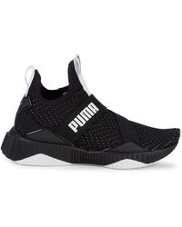 PUMA Defy Mid Core Perforated-knit Trainers - Black
