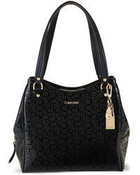 Calvin Klein Embossed Logo-print Shoulder Bag - Black