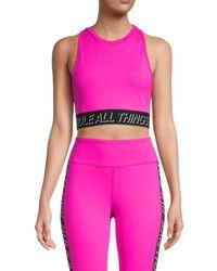 Pam & Gela - Women's Graphic Racerback Sports Bra - Pink - Size Xs - Lyst