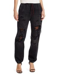 Alexander Wang Distressed Denim Jogger Trousers - Multicolour