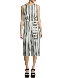 3196f2e4a45 Alice + Olivia Franny Gaucho Jumpsuit With Tie Belt in White - Lyst