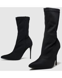 Schuh - Slinky Boots - Lyst