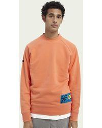 Scotch & Soda Raglansweater Met Grafisch Label - Oranje