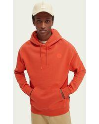 Scotch & Soda Sweat-shirt à capuche avec graphisme en mélange de coton - Orange