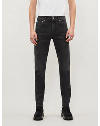 Alexander McQueen Logo-embroidered Tapered Jeans - Black