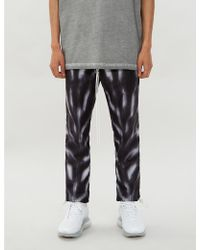 Nike X Fear Of God Loose-fit High-rise Printed Shell Pants - Black
