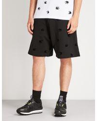 McQ - Swallow-flocked Wide-leg Cotton-jersey Shorts - Lyst