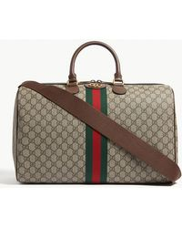94768276c Lyst - Gucci Brown Stripe Vintage GG Supreme Canvas Duffle Bag in ...