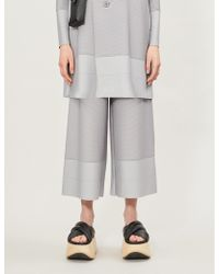 Issey Miyake Wide-legged Ribbed Stretch-jersey Trousers - Gray
