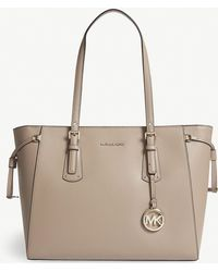 5fa1cfd971a3 MICHAEL Michael Kors - Michael Kors Truffle Beige Voyager Leather Tote Bag  - Lyst