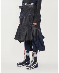 Nike Branded-waistband Shell And Mesh Skirt - Black
