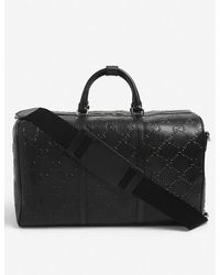Gucci GG Logo-embossed Leather Duffle Bag - Black