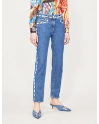 Moschino - Contrast Printed-trim Skinny Mid-rise Jeans - Lyst