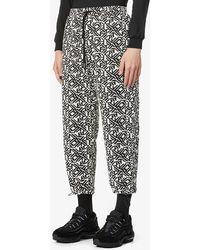 MKI Miyuki-Zoku Geometric Tapestry Wide Cotton-blend Trousers - Black