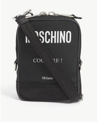 Moschino Brand-print Cotton-canvas Messenger Bag - Black