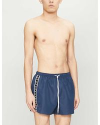 Calvin Klein Branded-tape Relaxed-fit Shell Shorts - Blue