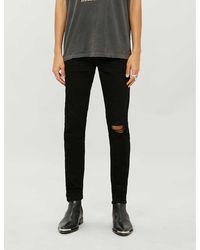 Amiri Ripped Skinny Stretch-denim Jeans - Black