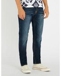 Evisu - Carrot-leg Brand-motto Denim Jeans - Lyst