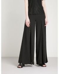 Huishan Zhang - Lace-trimmed High-rise Flared Crepe Trousers - Lyst